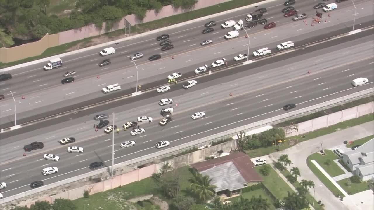 Aerial of vehicles getting around wreck on shoulder of I-95