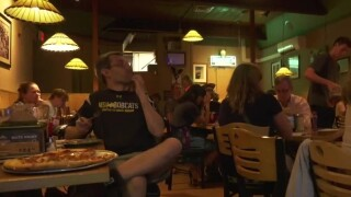 Pizza and politics: Young MT voters watch debate in Bozeman