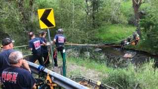 Motorcycle crash throws rider across Bear Creek