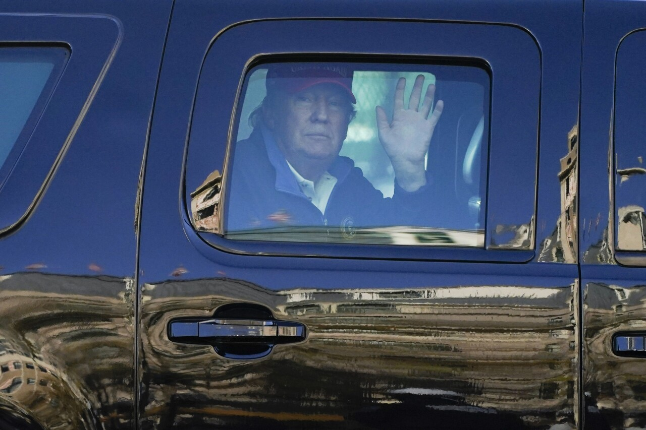 President Donald Trump waves to supporters during protests in Washington
