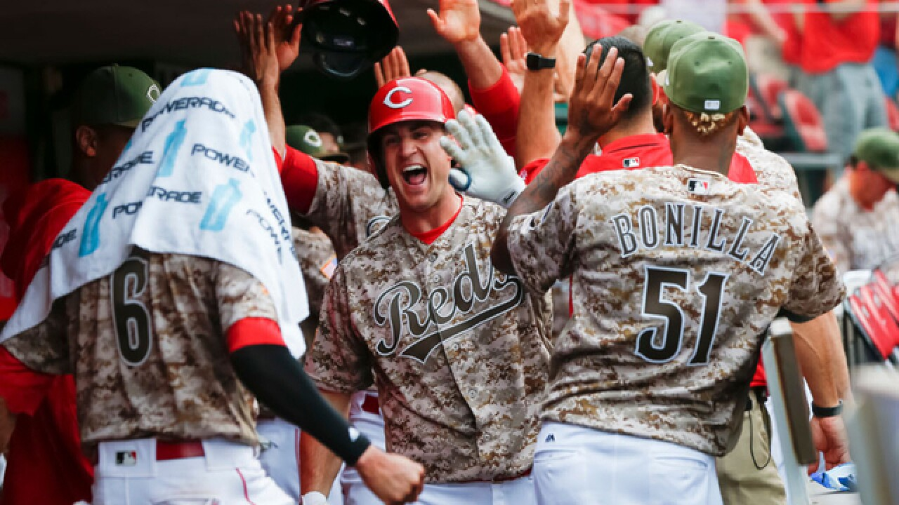 Reds rally to beat Rockies 12-8, break 7-game slide