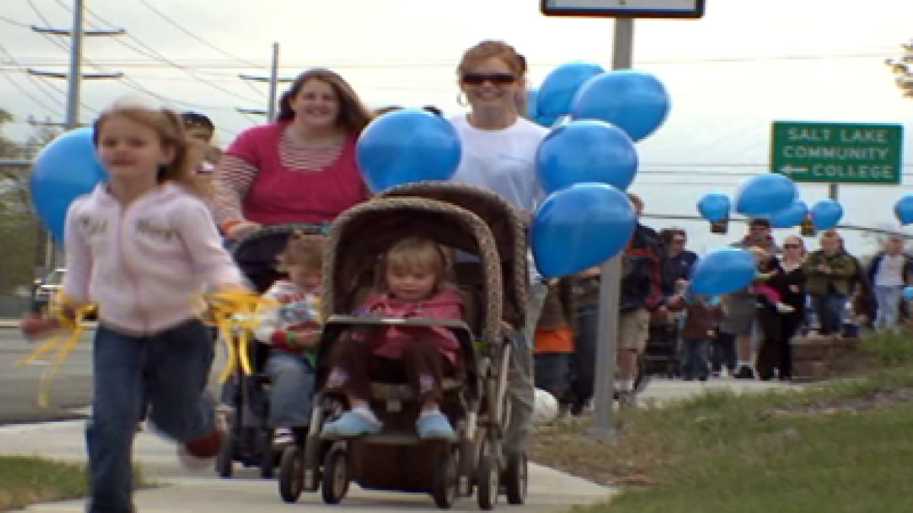 Supporters of child abuse prevention walk to raise awareness