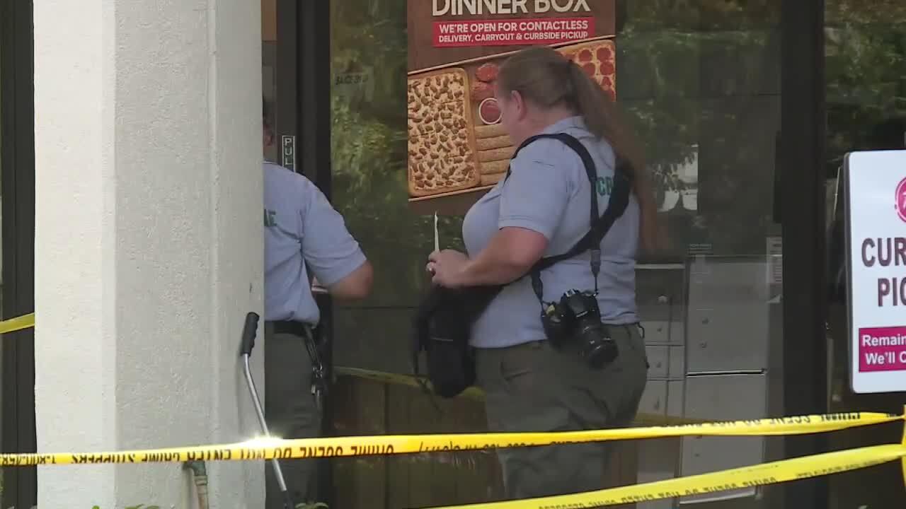 crime scene investigators collect evidence outside Pizza Hut at Coco Plum Plaza, Aug. 24, 2021