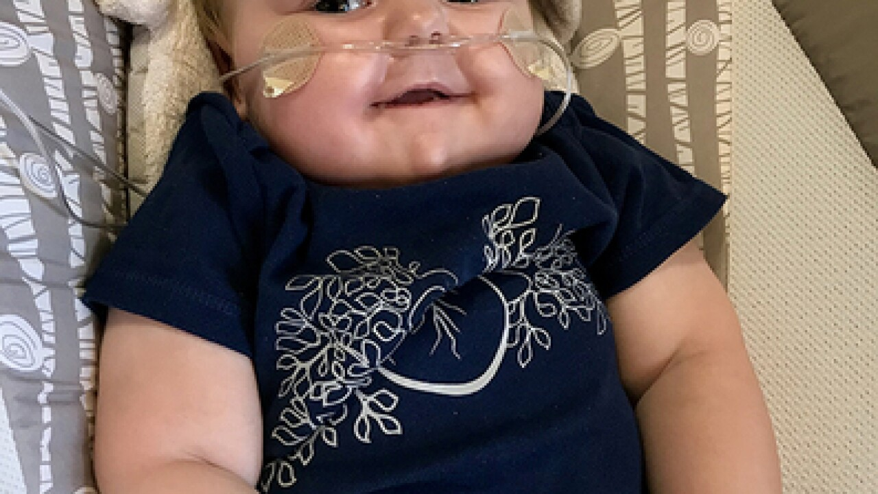 Infant heart-lung transplant recipient back home
