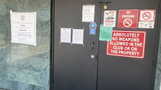A notice has been posted outside Curves Cabaret in Tucson, ordering the strip club closed for violating COVID-19 guidelines from the Arizona Department of Health Services.