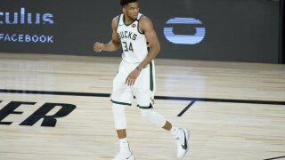 giannis ap photo bubble fist pump.jpeg