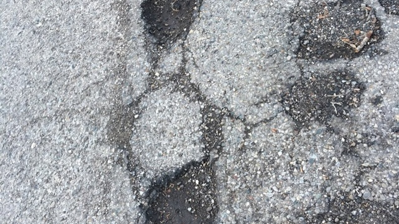 How is flooding linked to pothole problems?