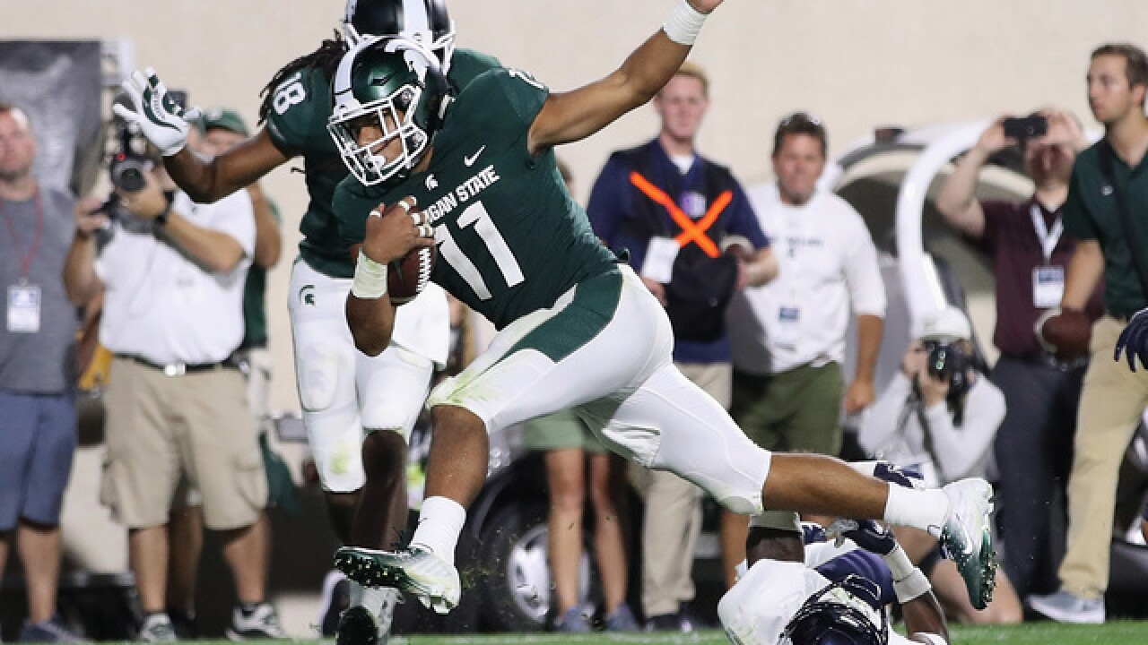 Late TD pushes Michigan State past Utah State