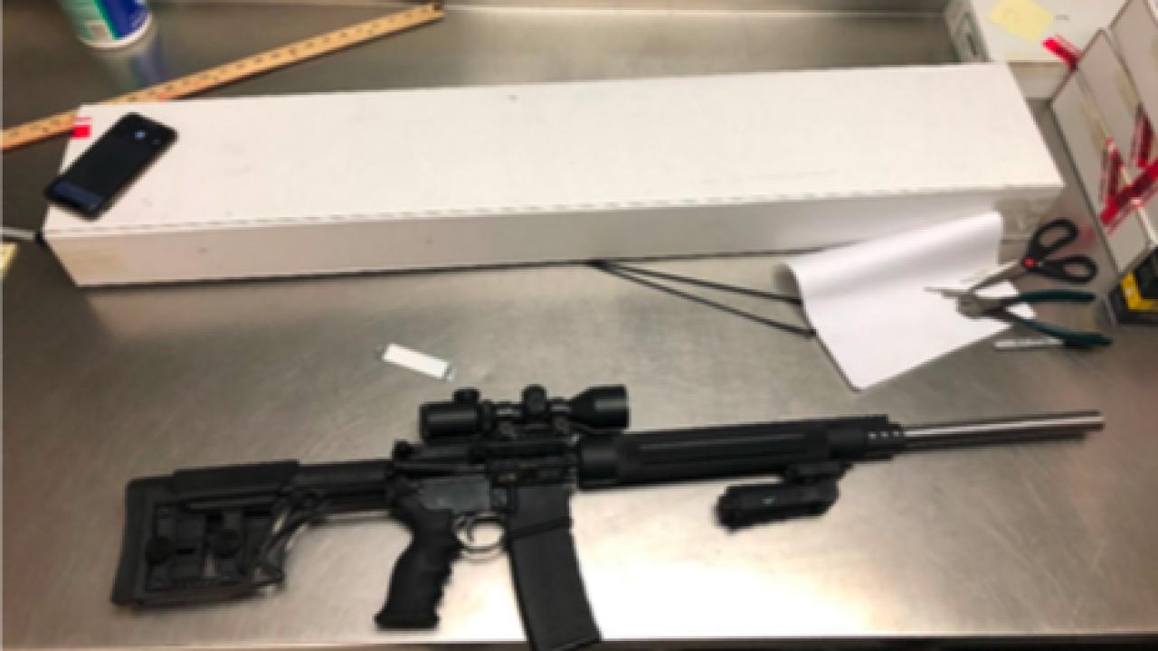 sniper rifle in richard platt's room.jpg