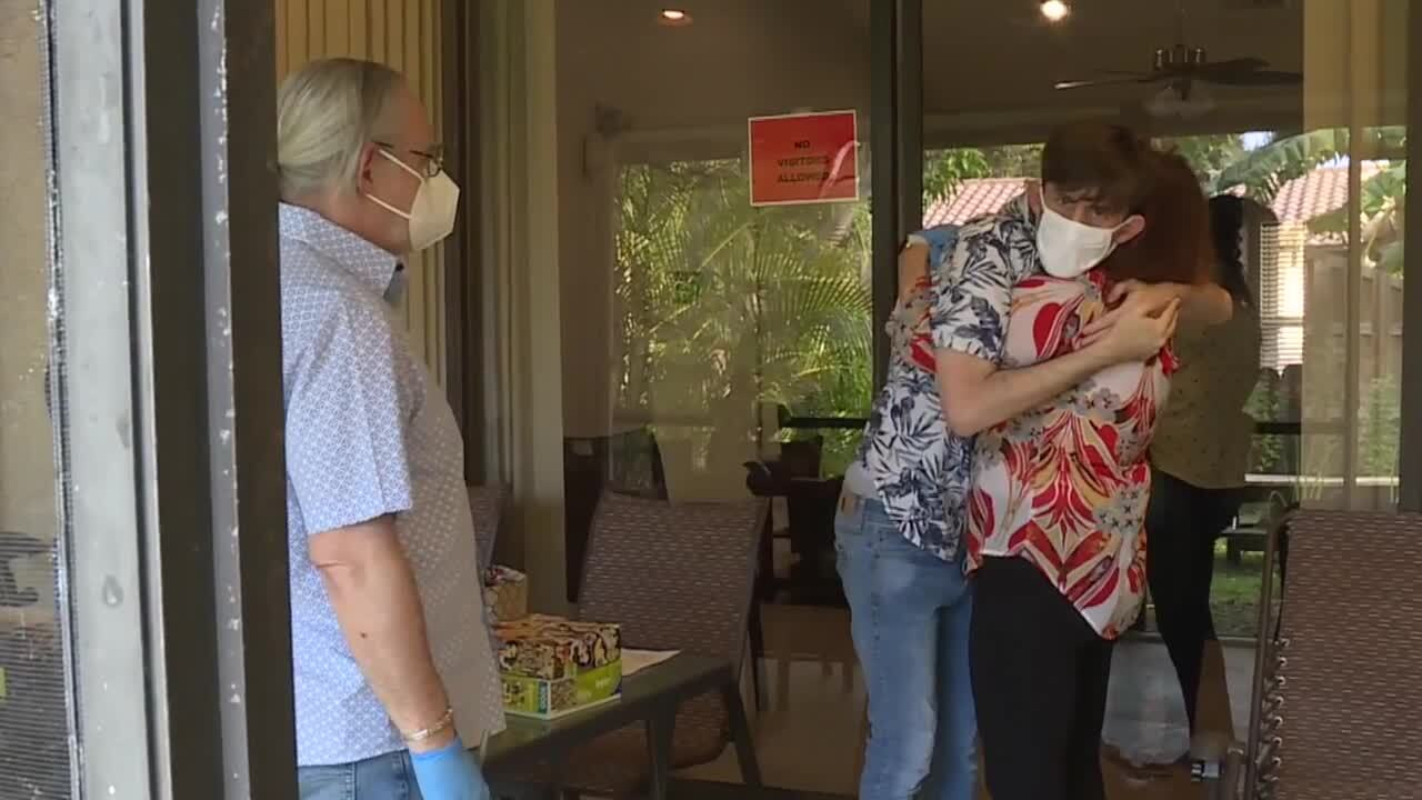 Daniel Rubenstein hugs mother Jaclyn Merens during group home visit