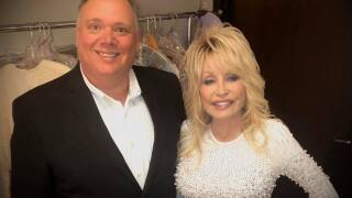 Kirt Webster backstage at the CMA Awards with Dolly Parton