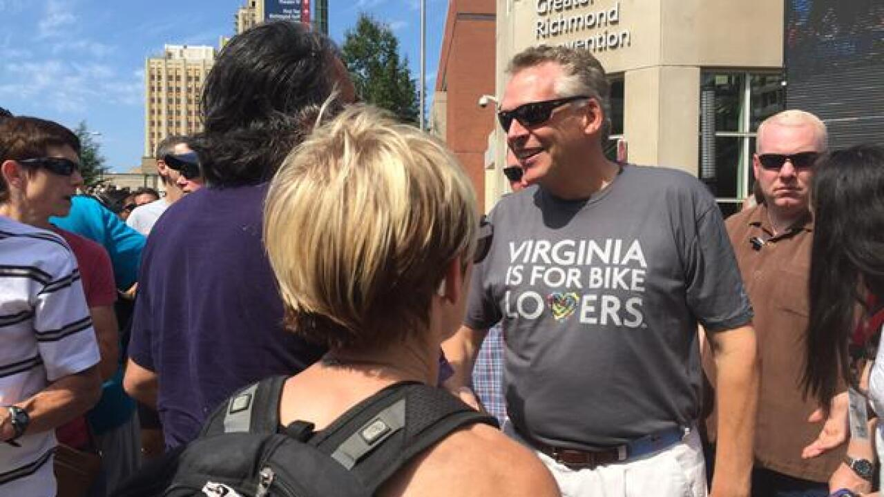 Video shows McAuliffe mixing with crowd at UCI finish line
