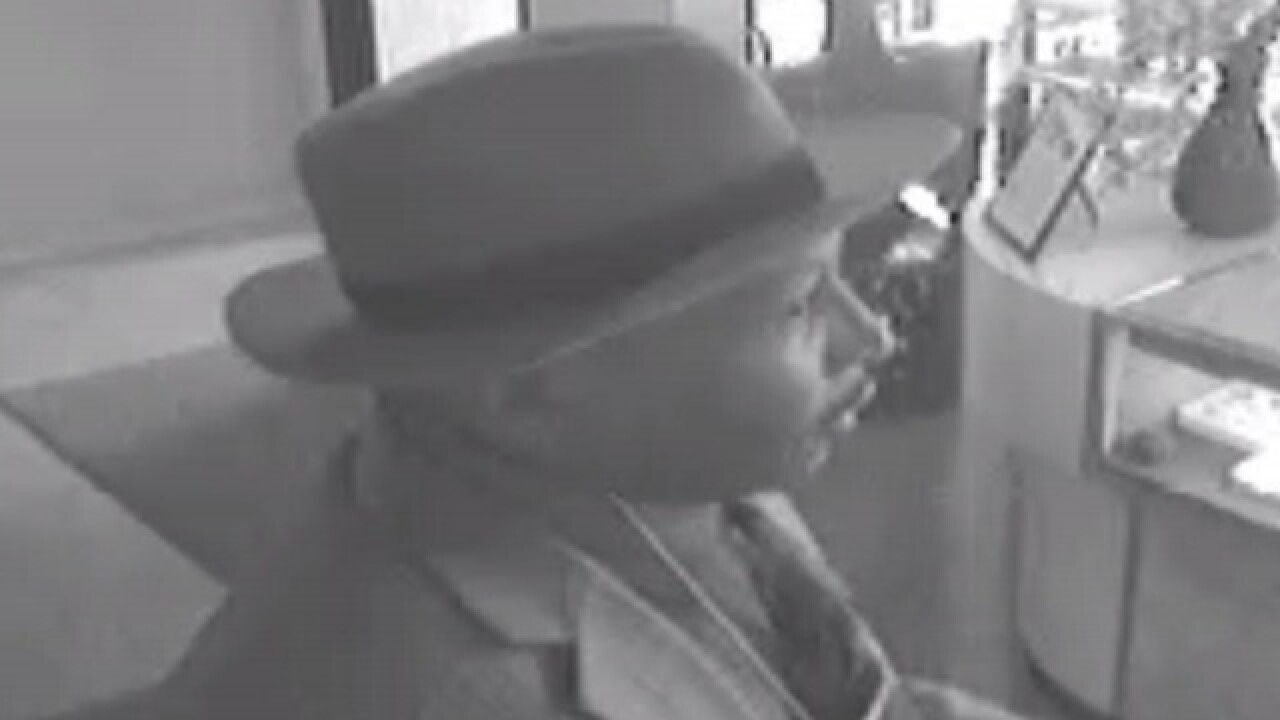 Well-dressed robber steals jewelry, car