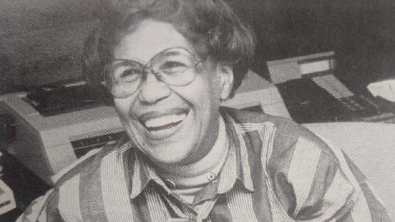 Gwen T. Jackson black and white photo smiling