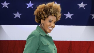 Macy Gray superimposed over American flag background