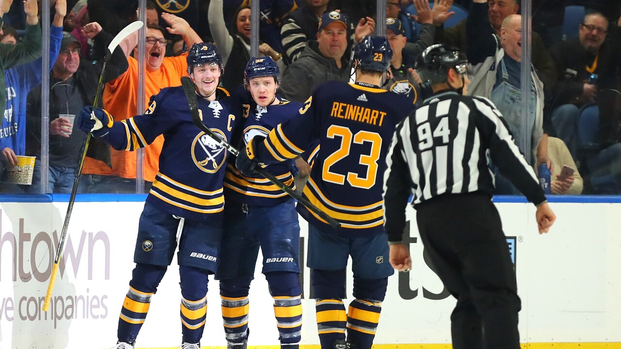 Jack Eichel, Sam Reinhart and Jeff Skinner celebrate en route to a Sabres win