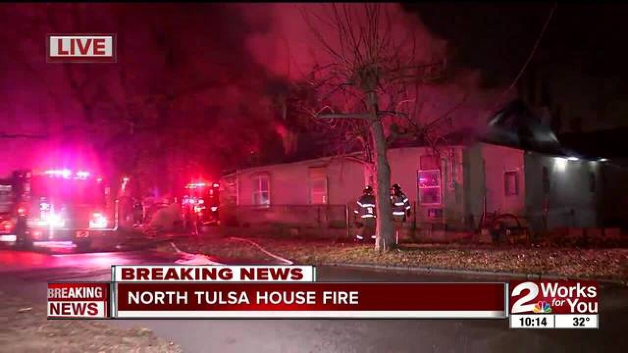 Crews battle late-night north Tulsa house fire