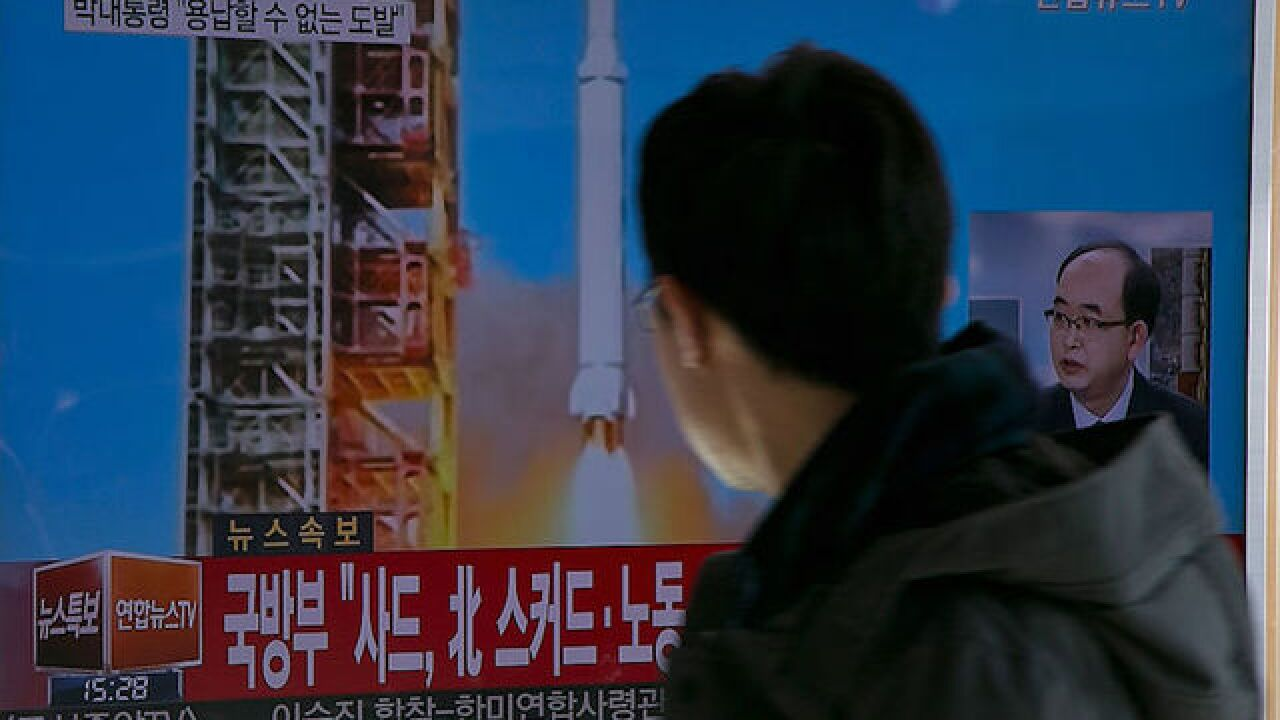 North Korea fires four ballistic missiles into Sea of Japan, PM Abe says