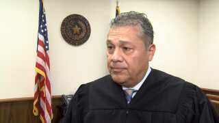 Judge Joe Benavides tells KRIS-TV that his condition is improving as he's moved out of ICU.
