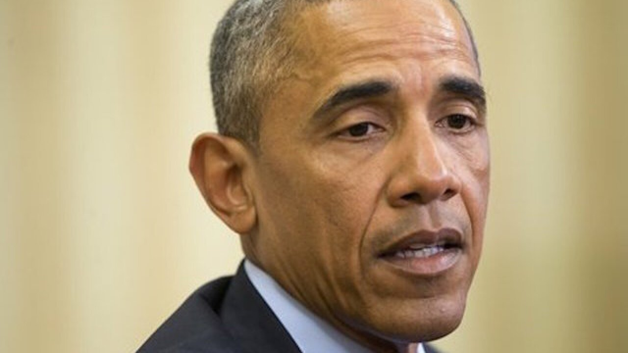 Obama defends his actions on gun control