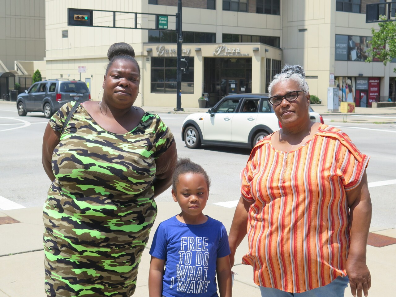 This photo shows Fonsea Bonner, left, her son in the center and Barbara Prince, right, posing outside the Gateway Plaza Apartments where they live.