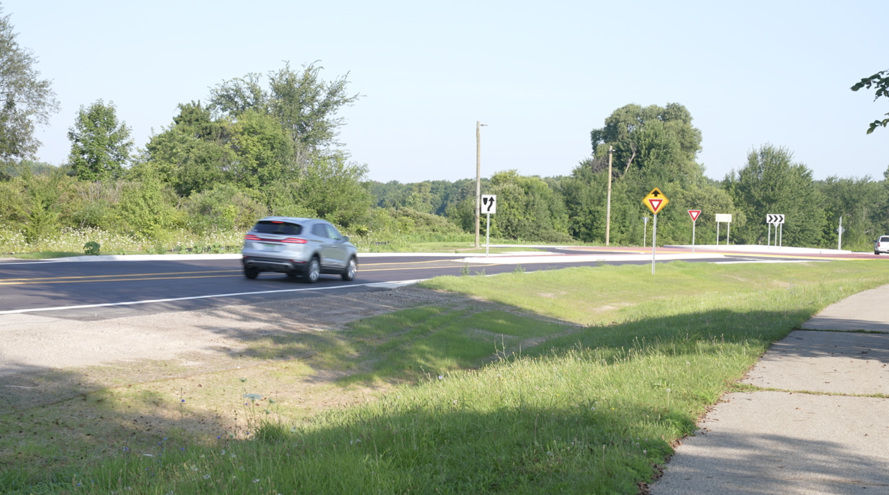 A car is approaching the roundabout