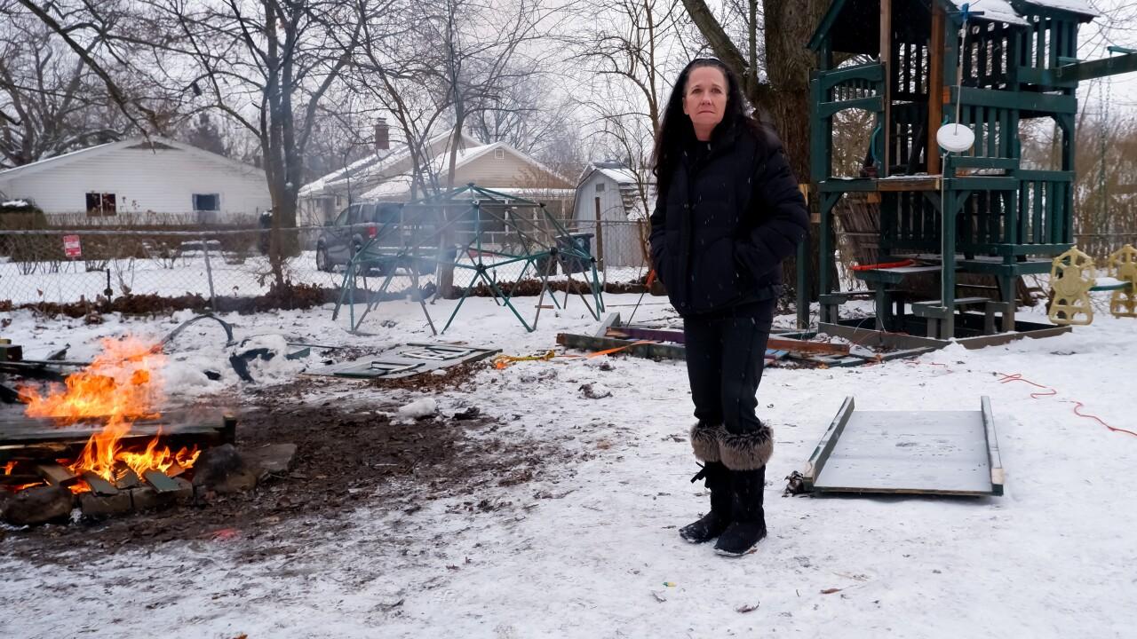 Virginia LaForce burns some of the family_s belongings in her backyard in February (Noor Hindi_The Devil Strip).jpeg