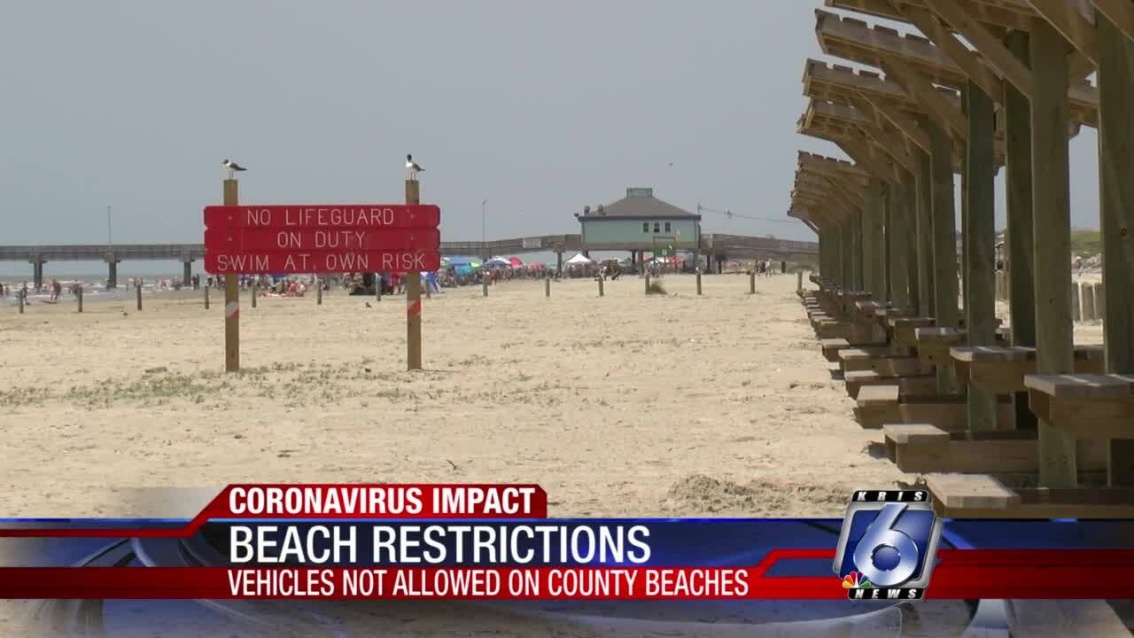 Beach crowds down today as vehicles banned again