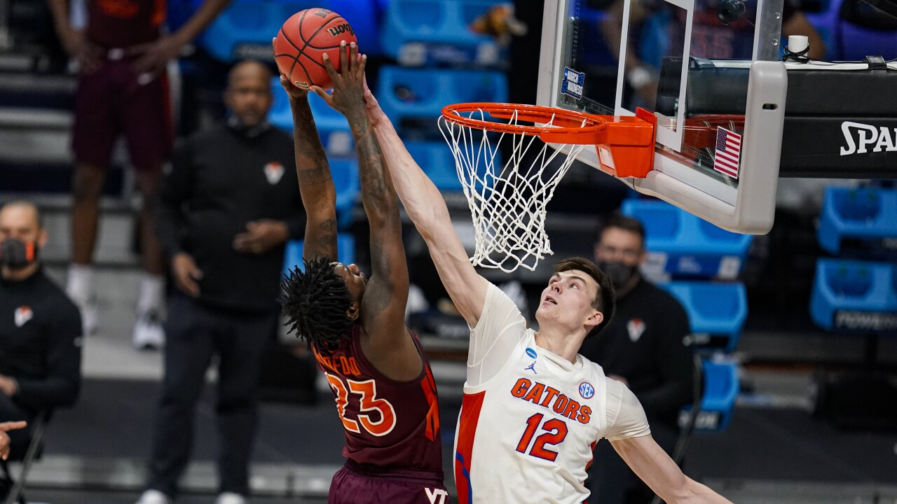 Florida Gators forward Colin Castleton blocks shot of Virginia Tech Hokies guard Tyrece Radford in 2021 NCAA tournament
