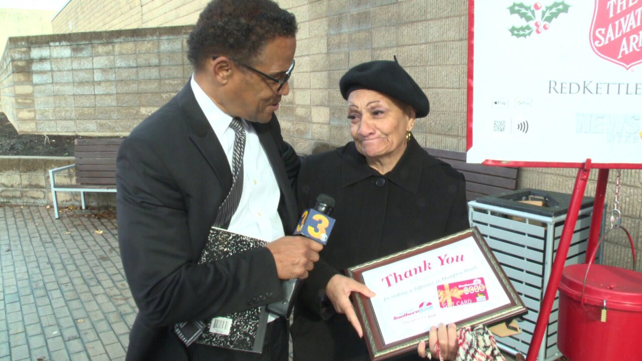 People Taking Action: Dedicated Salvation Army bell ringer fights back tears when surprised with award!