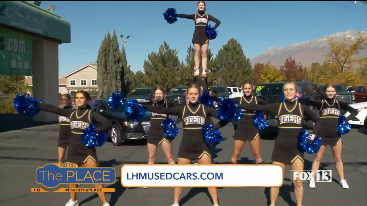 High School Cheerleaders join Budah at a tailgateparty