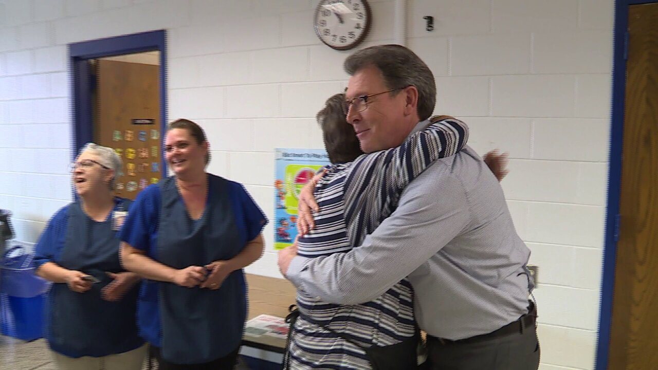 Rob Cardwell pays off lunch debt, surprises school cafeteria staffmembers
