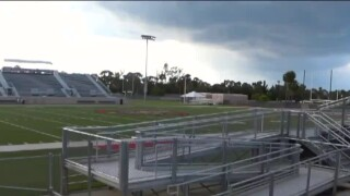 view of empty Oxbridge Academy football stadium after program shuttered in 2018