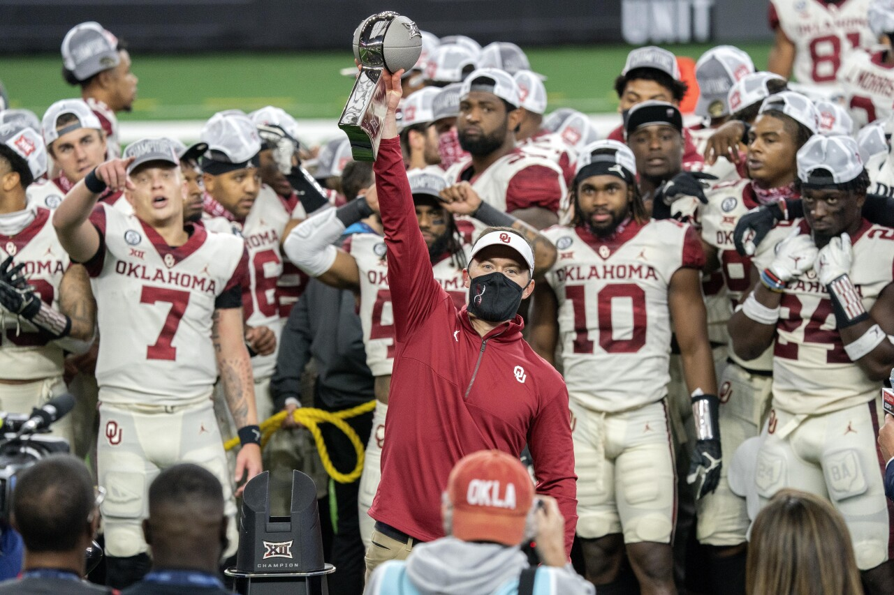 Oklahoma Sooners head coach Lincoln Riley hoists Big 12 Championship trophy in 2020