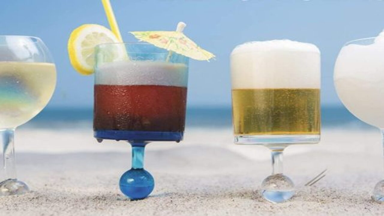 These Genius Wine Glasses Stick In The Sand And Float In The Pool