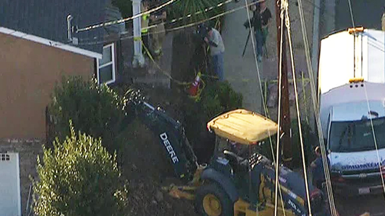 Man rescued after falling into trench