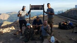 Mandy and Travis top Pikes Peak summit.jpg