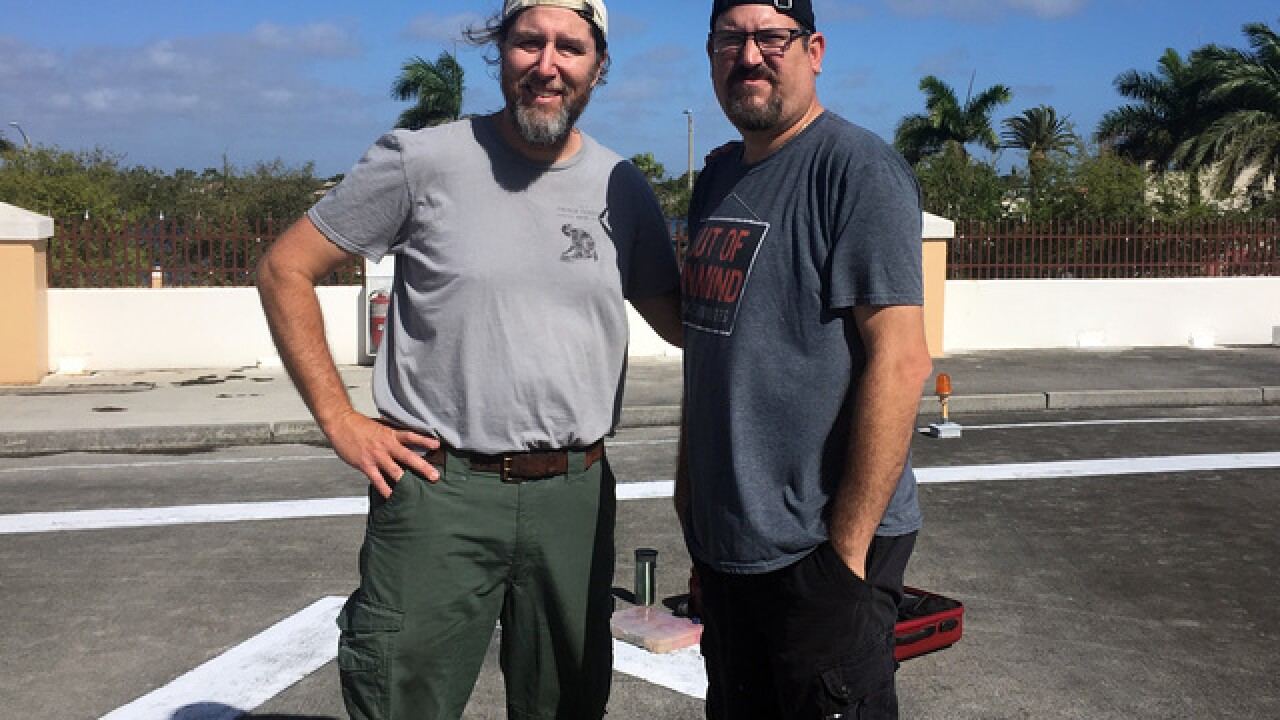 The Chalk Guys, Hector Diaz and Ken Mullen, create artwork at WPTV studios