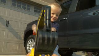 Three-year-old Oscar Nelson plays with his truck on his front driveway in West Haven. Oscar has been diagnosed with childhood apraxia of speech, a neurological disorder that requires speech therapy.