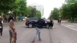 protester hit with car.jpeg