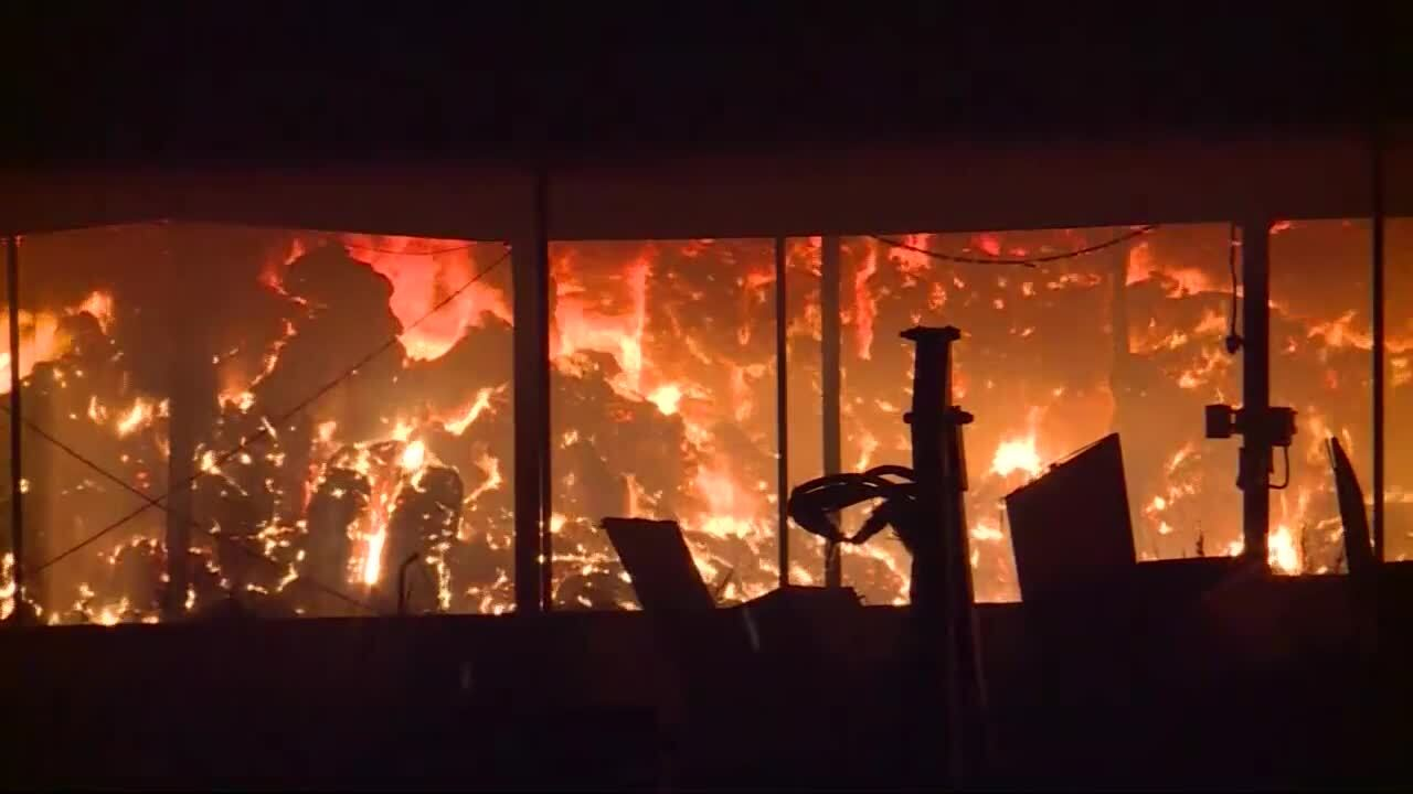 Crews work to contain large fire at Braum's facility in Tuttle