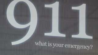 """911 what is your emergency?"" sign"