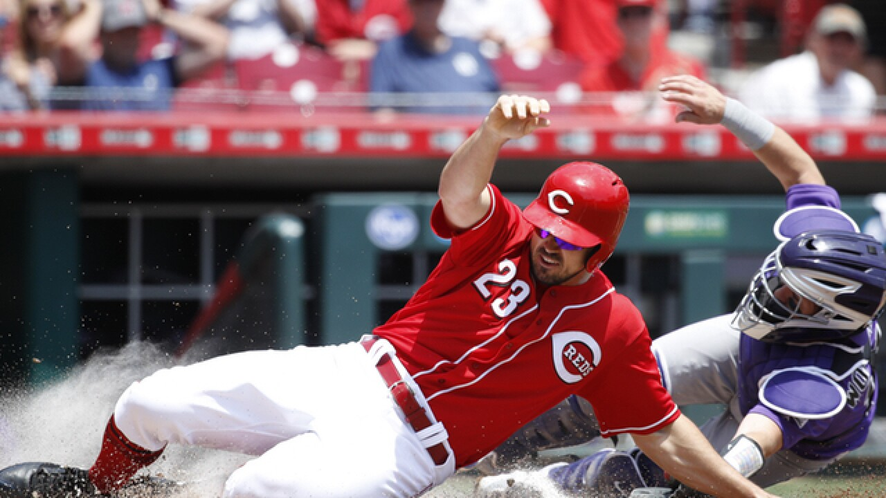 Winker's homer in 13th sends Reds over Rockies 7-5