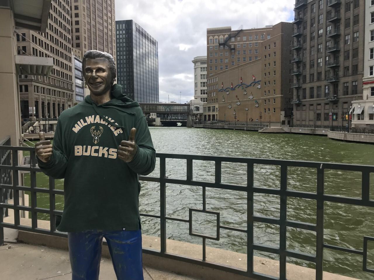 Fonze statue at Milwaukee River wearing Bucks sweatshirt