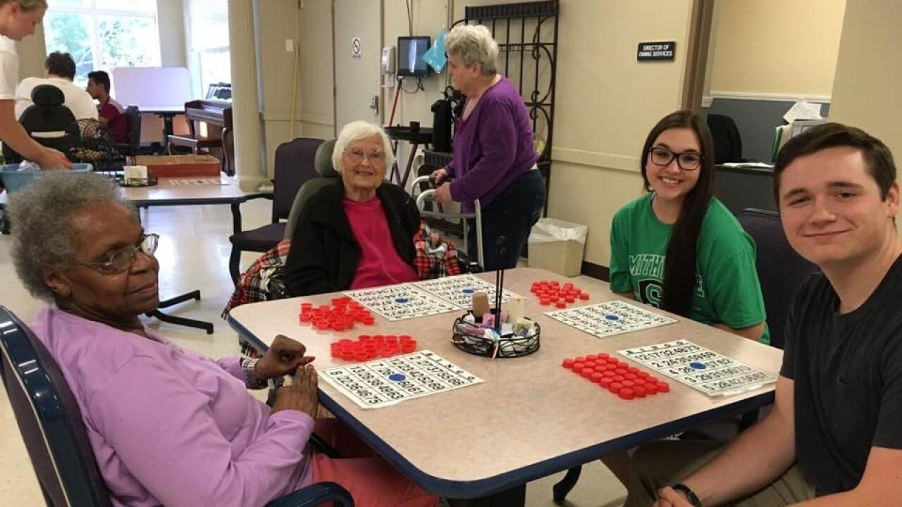 Blaize Madrid-Evans playing bingo with seniors