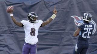 Baltimore Ravens QB celebrates 48-yard TD run vs. Tennessee Titans in wild-card playoff, Jan. 10, 2021