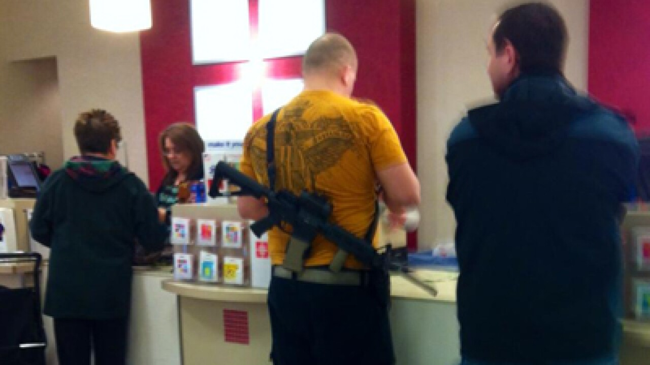 Photos capture man with a rifle shopping at JCPenney