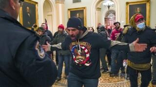 Photos: Trump supporters storm Capitol as Congress meets to confirm Biden's win