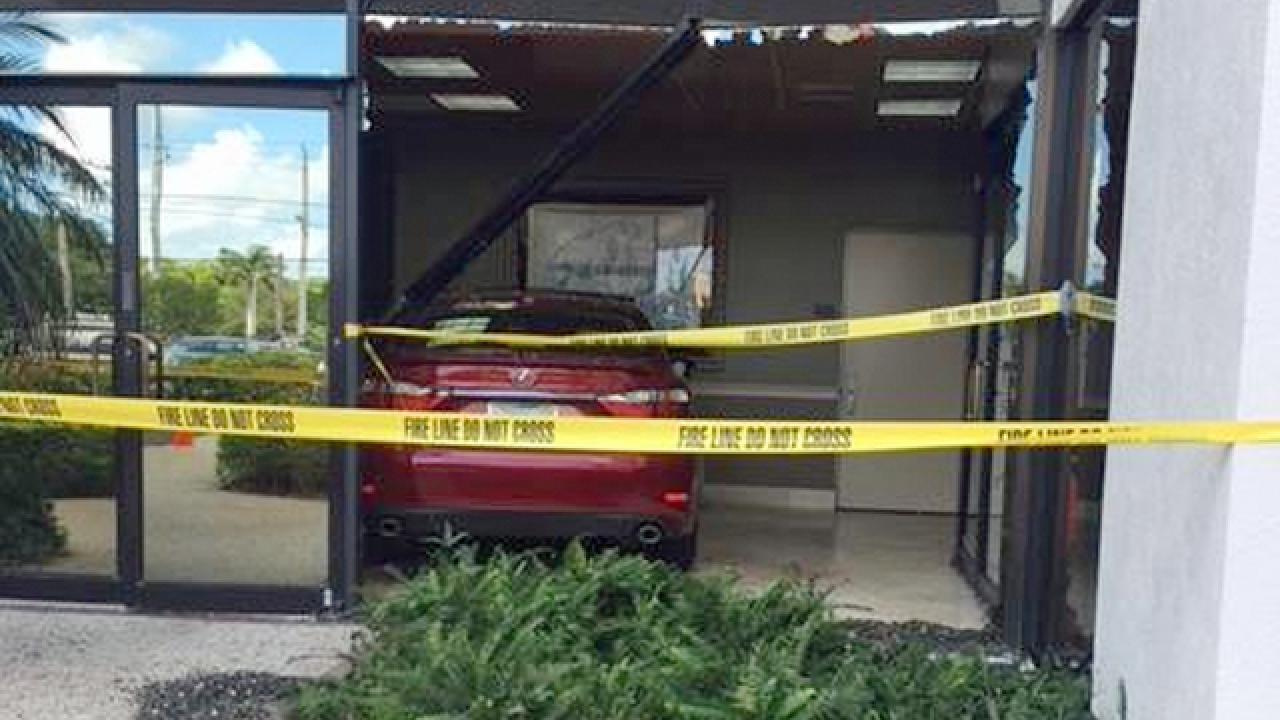Car slams into BankUnited building in Delray Beach