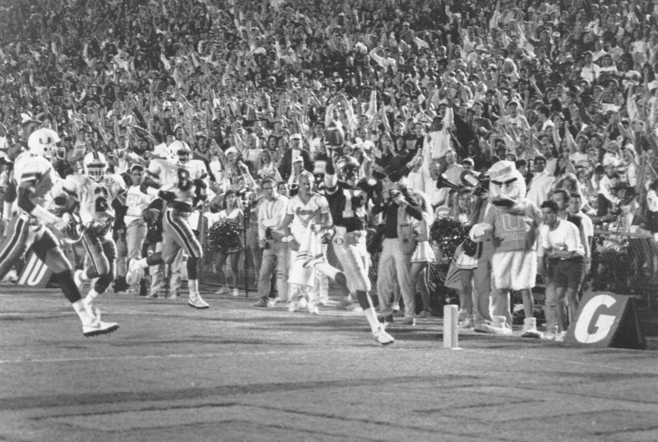 Florida State Seminoles running back Dexter Carter scores TD vs Miami Hurricanes in 1989 black and white